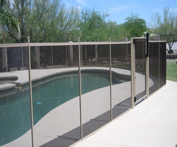 black and tan pool fence with pool gate