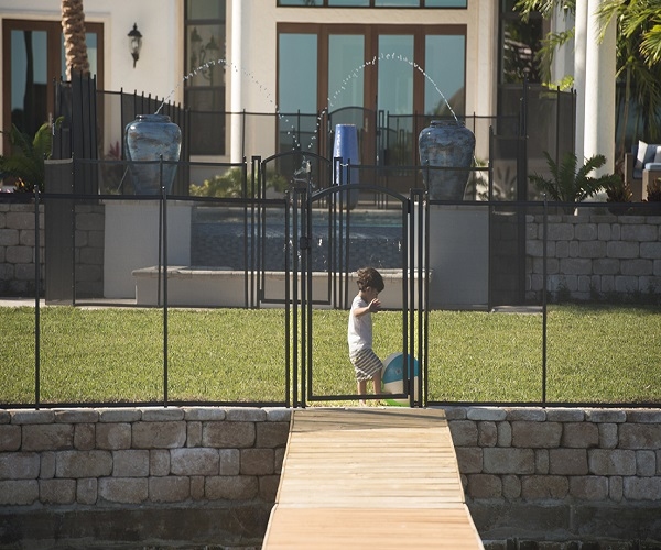 black pool fence with arched gate