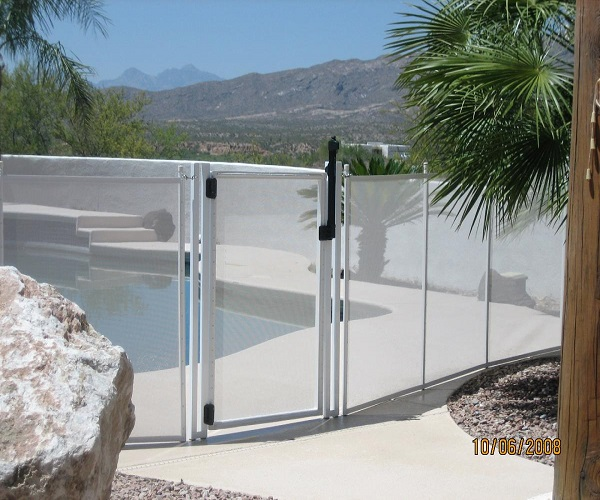 white pool fencing with a self-closing gate