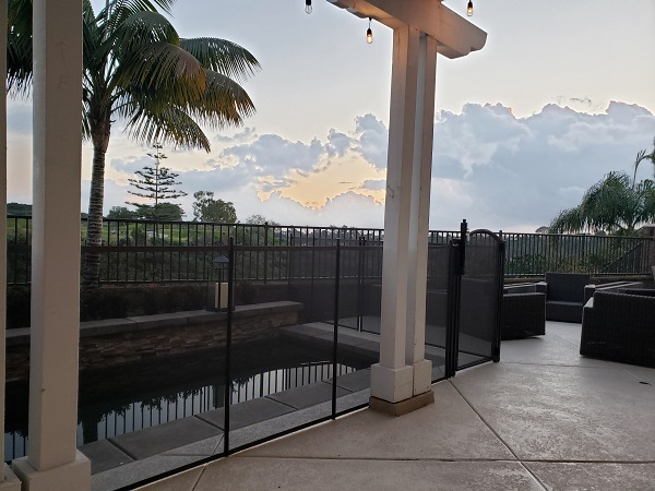 mesh pool fence with gate installed in Carlsbad, CA